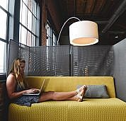 negative-space-woman-laptop-work-office-chilling-computer-couch-startup-stock-photos